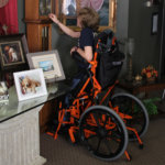 Arek Trenholm stands in his manual power standing wheelchair (thumbnail)